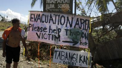 A sign asking for aid is posted by typhoon Bopha victims along a road in Maparat town in Compostela Valley, southern Philippines December 8, 2012. (Reuters / Erik de Castro)