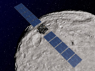 An artist's concept shows NASA's Dawn spacecraft orbiting the giant asteroid Vesta, as released by NASA December 12, 2011 (Reuters/NASA/JPL-Caltech/Handout)