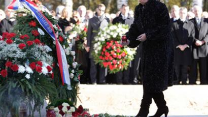 Russia's first lady Svetlana Medvedeva laying flowers at the memorial granite stone during the memorial events marking 6 months since the crash of the Polish Air Force Tu-154 aircraft which occurred near Smolensk on April 10, 2010. (RIA Novosti / Dmitry Astakhov)