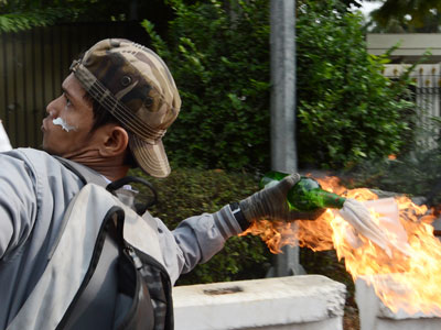 Indonesian police use tear gas to disperse anti-US protest
