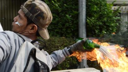 An Indonesian protester hurls a molotov coctail towards the US embassy during a protest against a low-budget film insulting to Muslims in Jakarta.(AFP Photo / Adek Berry)