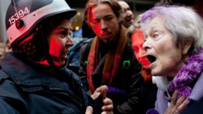 Occupy Wall Street protester, talks with police. (Andrew Burton/Getty Images/AFP)