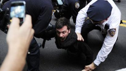 Members of Occupy Wall Street are arrested as they clash with police (AFP Photo / Emmanuel Dunand)