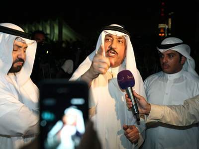 Kuwaiti MP Msallam al-Barrak (C) speaks to the press during a protest outside the national assembly in Kuwait City. (AFP Photo / Yasser Al-Zayyat)