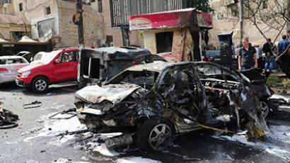 A wreckage of a burnt car following a bomb explosion outside a police station in a Christian quarter of Damascus' Old City on October 21, 2012. (AFP Photo / SANA)