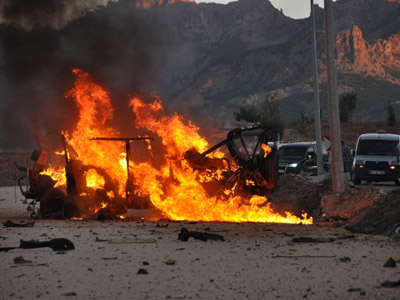 A vehicle burns after an explosion in the center of Tunceli on September 25, 2012. (AFP Photo/Str)