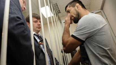 World fighting champion Rasul Mirzayev, right, tried for complicity in the murder of 19-year old Ivan Agafonov, and his lawyer Igor Dergachyov at Moscow's Zamoskvoretsky court (RIA Novosti / Ramil Sitdikov)