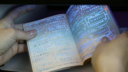 Passport check at the Commercial Seaport Kaliningrad border crossing point (RIA Novosti/Igor Zarembo)