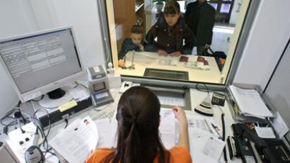 Official issuing Schengen visas (RIA Novosti/Igor Zarembo)
