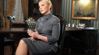 Kiev : Ukraine's former Prime Minister and a leader of the opposition Yulia Tymoshenko gestures as she speaks to a journalist in her residence in Kiev during her interview for AFP on February 2, 2011. (AFP Photo/ Sergei Supinsky)