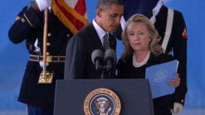 US President Barack Obama and Secretary of State Hillary Clinton attend the transfer of remains ceremony marking the return to the US of the remains of the four Americans killed in an attack this week in Benghazi, Libya, at the Andrews Air Force Base in Maryland on September 14, 2012. (AFP PHOTO / Jewel Samad)