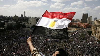 Egypt, Cairo: An Egyptian protester waving his national flag as tens of thousands gather for a demonstration at Cairo's Tahrir Square on April 8, 2011 (AFP Photo / Misam Saleh)