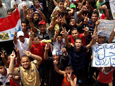 Supporters of Muslim Brotherhood presidential candidate Mohamed Morsi in Cairo's landmark Tahrir square on June 23, 2012 (AFP Photo/Marwan Naamani)
