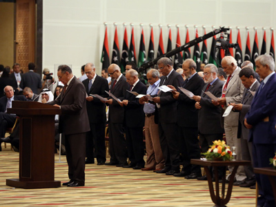 Members of the National Congress of the year during the performance of the constitutional right during the transfer of authority ceremony in tripoli on August 8, 2012 (AFP Photo / Mahmud Turkia)