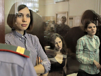 Members of the Pussy Riot punk band (from left in the background) Nadezhda Tolokonnikova, Maria Alyokhina and Yekaterina Samutsevich during the hearings on the merits on their case in Moscow's Hamovniki Court. (RIA Novosti/Andrey Stenin)