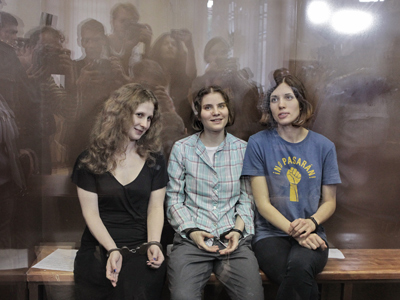 Members of the punk band Pussy Riot Maria Alekhina, Yekaterina Samutsevich and Nadezhda Tolokonnikova (from left), charged with hooliganism in Christ the Savior Cathedral, after the verdict in their case was announced in Khamovnichesky court in Moscow (RIA Novosti /  Andrey Stenin)