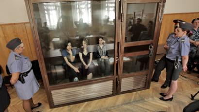 The members of the Pussy Riot punk band (from left in the dock) Nadezhda Tolokonnikova, Maria Alyokhina and Ekaterina Samutsevich (RIA Novosti / Andrey Stenin)