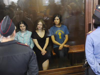 From left: Pussy Riot punk group members Yekaterina Samutsevich, Mariya Alekhina and Nadezhda Tolokonnikova, charged with hooliganism in Moscow\s Cathedral of Christ the Savior, hear the verdict announced in their trial in Moscow's Khamovnichesky Court (RIA Novosti / Alexander Utkin)