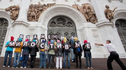 "Supporters of female punk group Pussy Riot hold signs to form the message ""Blessed are the merciful"" during a protest on the steps of the Cathedral of Christ the Saviour in Moscow (REUTERS / Stringer)"