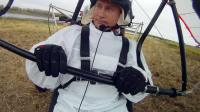 "Russian President Vladimir Putin takes part in a scientific experiment as part of the ""Flight of Hope"", which aims to preserve a rare species of - cranes. At the helm of a trike that the birds have taken as their leader, Putin made three flights - the first to get familiar, and two others with the birds. 5 September 2012. (RIA Novosti)"