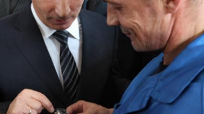 Russian Prime Minister Vladimir Putin (L) visiting the KBP Instrument Design Bureau (photo by Dmitry Azarov/Kommersant)