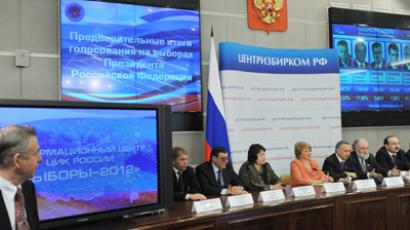 Members of Russia's Central Election Commission hold a news conference on the preliminary results of the 2012 Russian presidential election at the Central Election Commission's Election 2012 information center (RIA Novosti / Ruslan Krivobok)