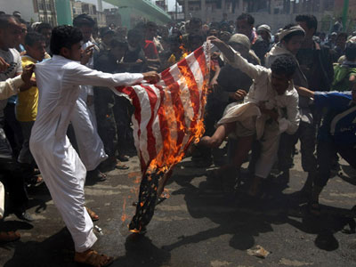 Yemeni protesters burn a US flag during a demonstration at a street leading to the US embassy in Sanaa on September 14, 2012 against a film mocking Islam  (AFP Photo/Mohammed Huwais)