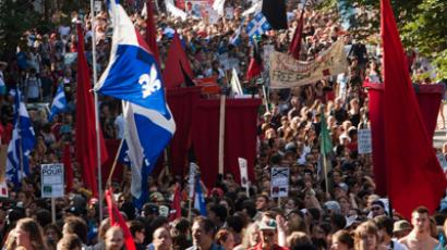 Red square flags symbolizing support towards Quebec student protests are seen as thousands of demonstrators march against student tuition fee hike on August 22, 2012, in downtown Montreal (Reuters / Olivier Jean)