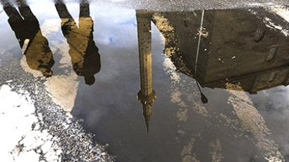 Serbia, Pristina: Kosovo Police are reflected in a puddle near the grand mosque in Pristina on September 9, 2010. (AFP Photo / Armend Nimani)