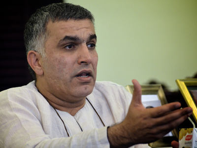 Bahraini Shiite human rights activist Nabeel Rajab speaks at his home in the village of Bani Jamrah, West of Manama, after he was released from jail on June 27, 2012. (AFP Photo/Mohammed Al-Shaikh)