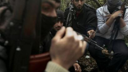 Armed Syrian men, members of the rebel Free Syrian Army, gather in a mountainous area of the restive Idlib province in northwestern Syria on March 13, 2012. (AFP Photo/Ricardo Garcia Vilanova)