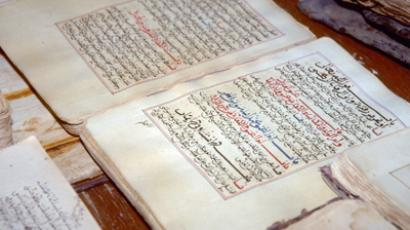 Ancient manuscripts displayed at the library in the city of Timbuktu. Islamists fleeing Timbuktu in the face of a French-led offensive have torched a building housing ancient Arabic manuscripts, security and army sources said on January 28, 2013 (AFP Photo / Evan Schneider)