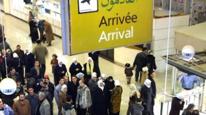 People wait at the arrivals in Damascus International airport (AFP Photo/Louai Beshara)