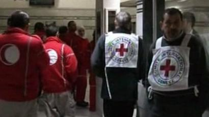 Red Crescent and Red Cross medics at a hospital in the Syrian city of Homs (AFP Photo / HO / Syria TV)