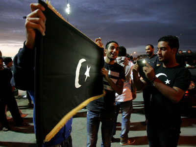 Libyan protesters hold the flag of the eastern Cyrenaica region during a demonstration calling for greater autonomy in the eastern city of Benghazi (AFP Photo / Abdulah Dohma)