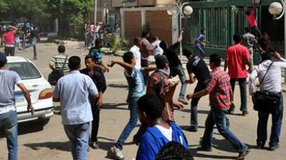 Egyptian protesters throw stones at a police station in Suez on July 6, 2011. (AFP Photo / STR)