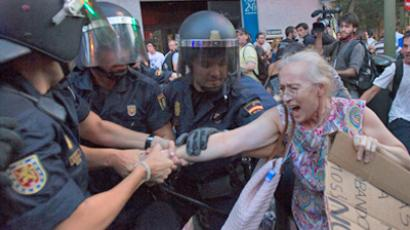 Riot police arrest a woman during a protest outside the Spanish socialist PSOE party headquarters in Madrid July 13, 2012 (Reuters/Juan Medina)