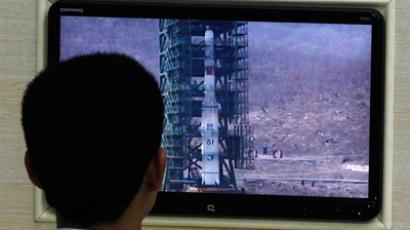 A North Korean scientist looks at a monitor showing the Unha-3 (Milky Way 3) rocket on a launch pad at the West Sea Satellite Launch Site, at the satellite control centre of the Korean Committee of Space Technology on the outskirts of Pyongyang April 11, 2012 (Reuters/Bobby Yip)