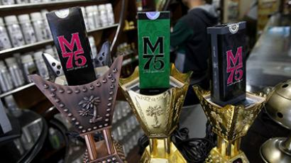 "Packaged M75 perfume bottles are displayed at the ""Stay Stylish"" shop in Gaza City on December 10, 2012. (AFP Photo / Mohammed Abed)"