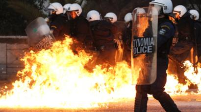 A petrol bomb explodes near riot police during a huge anti-austerity demonstration in Athens, February, 2012. (Reuters / Yiorgos Karahalis)