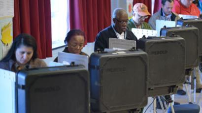 Voters cast their ballots in a polling station at the Holiday Park Senior Center on November 6, 2012.(AFP Photo / Mandel Ngan)