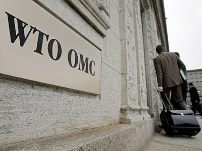 Officials arrive at World Trade Organization (WTO) headquarters in Geneva (AFP Photo / Fabrice Coffrini)