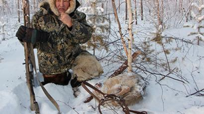 Hunter Pavel Vasilyev kneels next to a trapped wolf outside the eastern Siberian city of Yakutsk in the Sakha (Yakutia) Republic January 10, 2013. (Reuters)