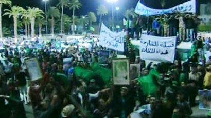 "An image grab taken on February 21, 2011 off Libya's state television station shows what the channel said were supporters of Libyan leader Muammar Gaddafi gathering in Tripoli's Green Square on February 21, 2011, while it reported that Libyan security forces are targeting ""dens of terrorists"" and urged Libyan citizens to cooperate with the operation to restore security in the country (AFP Photo / HO / Libyan TV)"