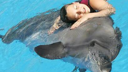 Post-stroke patients with paralysis to recuperate through an illusion of becoming… a dolphin