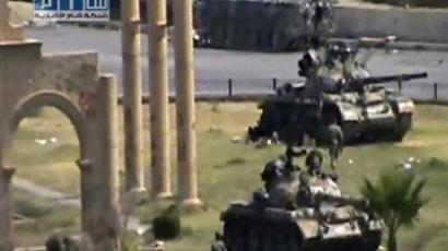 Amateur video purportedly shows tanks on streets of Hama (AP)
