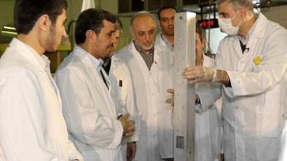A handout picture released by the Iranian presidency shows the Islamic republic's President Mahmoud Ahmadinejad (2nd L) and Foreign Minister Ali AKbar Salehi (C) listening to an expert during a tour of Tehran's research reactor centre on February 15, 2012 (AFP Photo / Iranian Presidency)