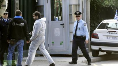 Police investigators enter the Russian embassy in Athens  (AFP Photo/ Louisa Gouliamaki)