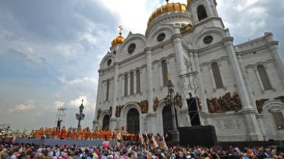Tens of thousands of Orthodox Christians have joined a service outside Moscow's main church, the Cathedral of Christ the Savior, in defense of their faith. (RIA Novosti/Ramil Sitdikov)