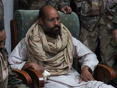 Saif al-Islam is seen after his capture, in the custody of revolutionary fighters in Obari, Libya November 19, 2011 (Reuters/Ammar El-Darwish)